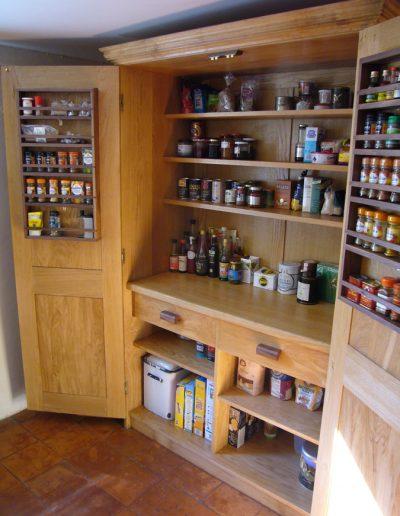 Inside of pantry in oak
