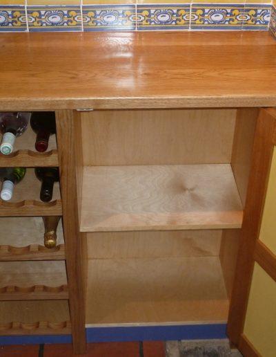 Wine rack in oak kitchen cabinet